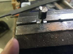 Cleaning up the bottom of the pin in a vice